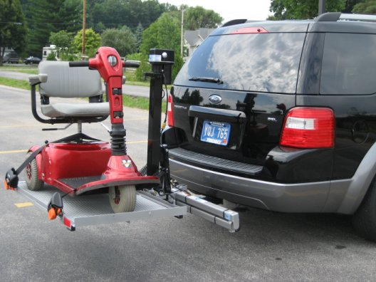 Vans wheelchairs car autos weblog for Motorized wheelchair lifts for cars